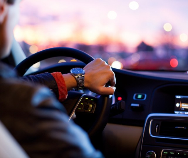 a man holding a steering wheel